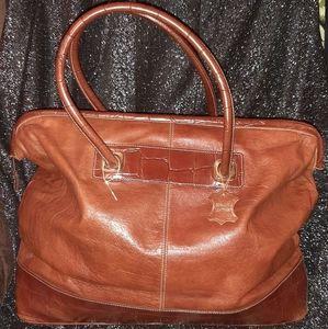 Leather  travel bag color more like caramel